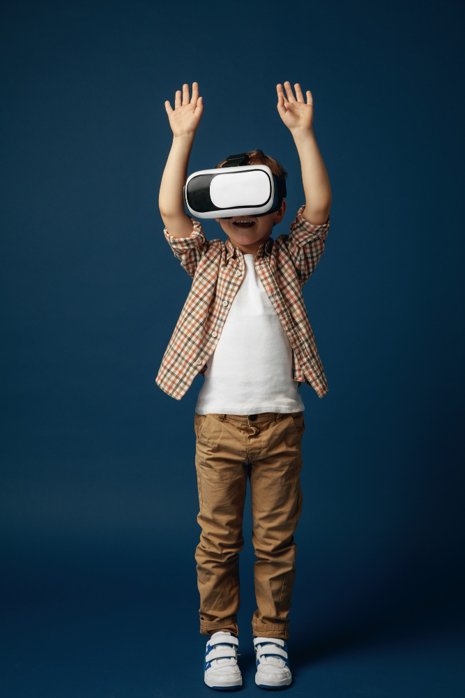 fall-love-with-hi-tech-little-boy-child-jeans-shirt-with-virtual-reality-headset-glasses-isolated-blue-studio-background-concept-cutting-edge-technology-video-games-innovation